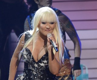 http://cdnph.upi.com/sv/em/upi/UPI-7951371691720/2013/1/a7b7142155ed3406a1bb5131f714903e/Christina-Aguilera-shows-off-weight-loss-on-The-Voice-finale.jpg