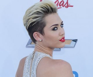 http://cdnph.upi.com/sv/em/upi/UPI-9071372388050/2013/1/8d9a0ce21a3c91546cf441782415c07d/Miley-Cyrus-on-Jimmy-Kimmel-Singer-talks-getting-high-with-Snoop-Lion.jpg