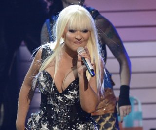 http://cdnph.upi.com/sv/em/upi/UPI-9601375064387/2013/1/a7b7142155ed3406a1bb5131f714903e/Christina-Aguilera-shows-off-slim-figure-at-Voice-event.jpg