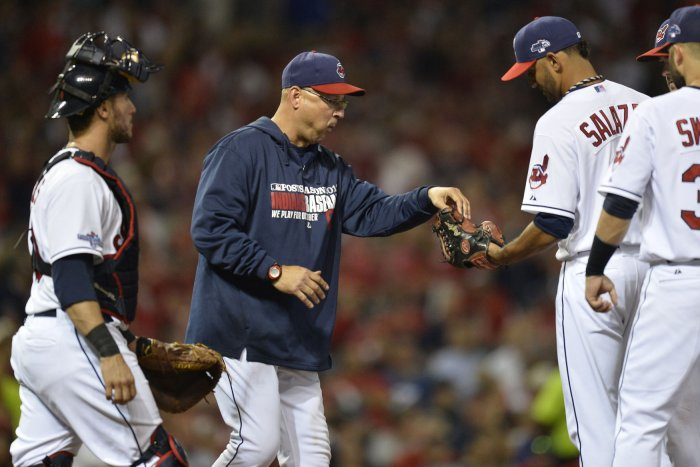 e4cb64710aa55 FLASHBACK  Terry Francona (C) takes the ball from Danny Salazar as he is  relieved in the fifth inning against the Tampa Bay Rays in the AL Wildcard  Game at ...