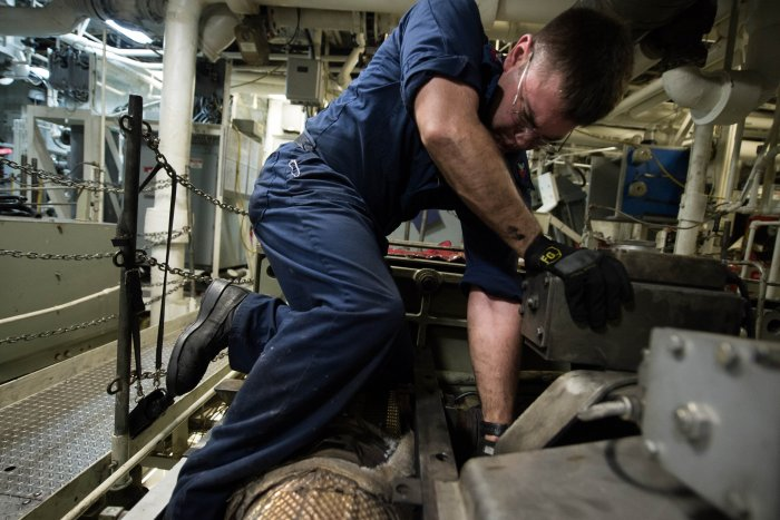 an engineer works on the diesel engine inside aboard the uss freedom photo by us navy msc 3rd class karolina a osegueraupi