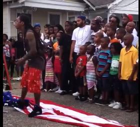 Lil Wayne tramples American flag while filming music video