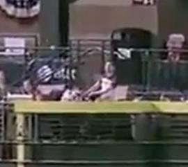 [VIDEO] Man ducks, lets ball hit woman in the face at baseball game