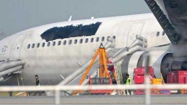 Airline covers logo on plane after malfunction