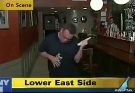 News reporter plays air guitar during live television newscast