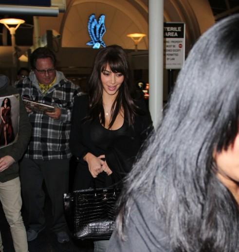 Kim Kardashian: The bangs are fake!