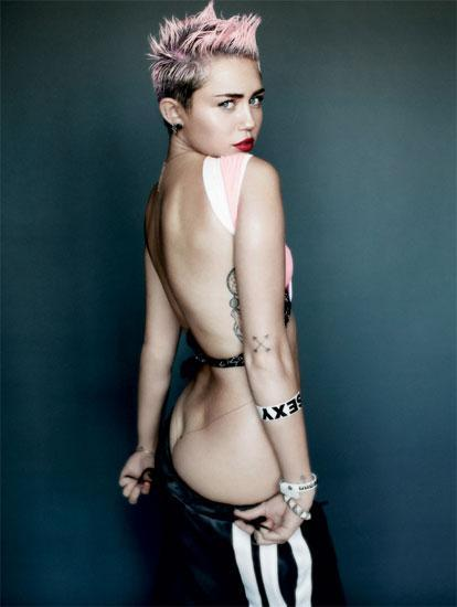 Miley Cyrus shows some skin in racy V cover shoot