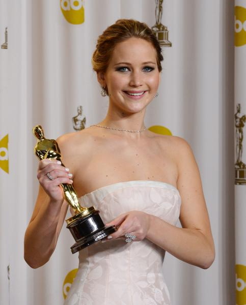 Jennifer Lawrence photographed without makeup, maybe smoking a joint in Hawaii