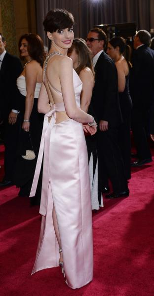 Anne Hathaway debuts blonde hair at punk-themed Met Ball