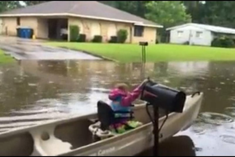 Watch: Girl Helps Neighbors Get Mail On Flooded Street