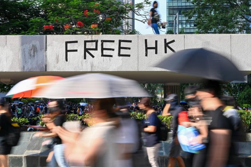Defying ban, protesters march in Hong Kong, clash with ...