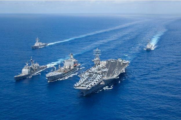 Aircraft carrier strike groups Nimitz Reagan team up in Philippine Sea.