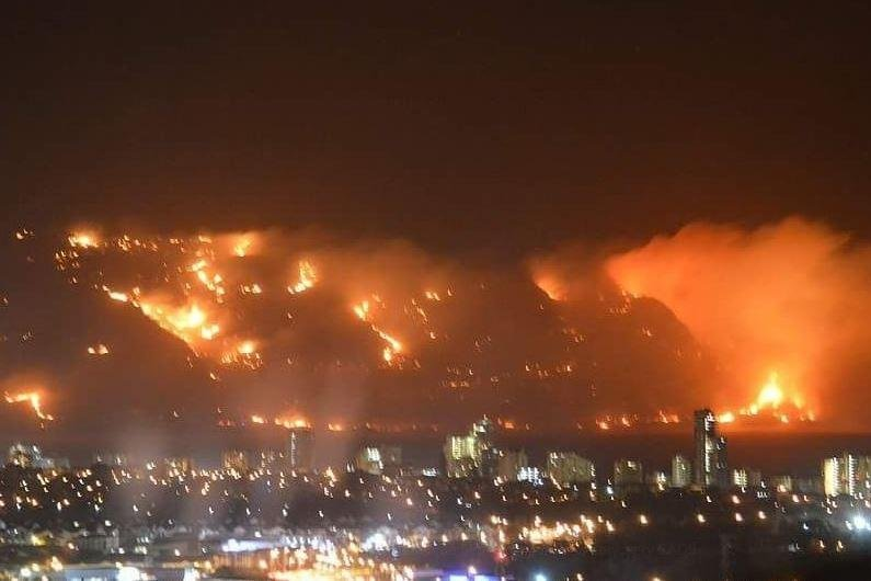 homes burn as wildfires whip south african capital