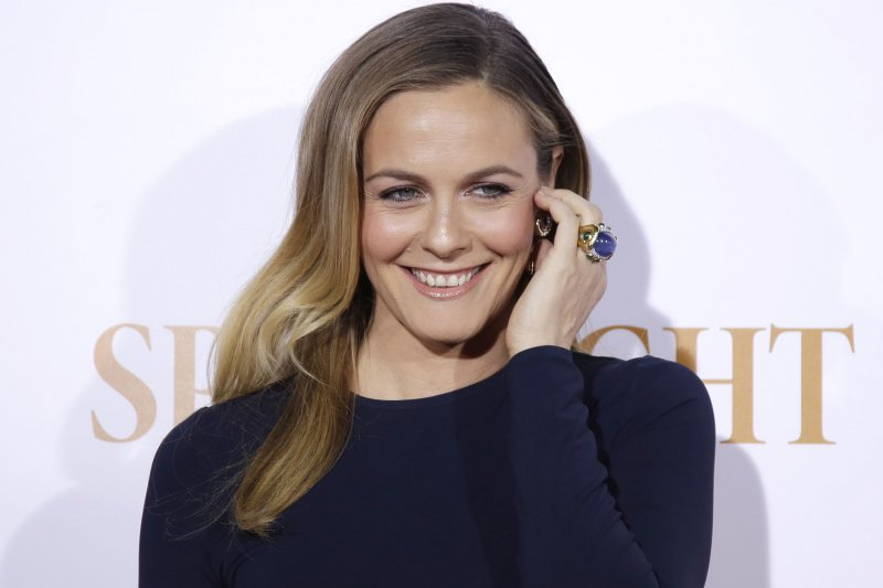 Alicia Silverstone Strips in PETAs Id Rather Go Naked