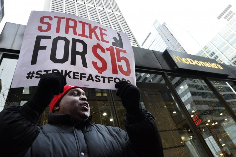 U.S. businesses take minimum wage hikes, added sick leave to court