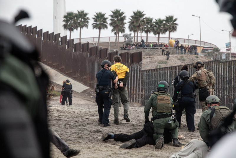 San Diego Electric >> U.S. agents arrest more than 30 at immigration protest on ...