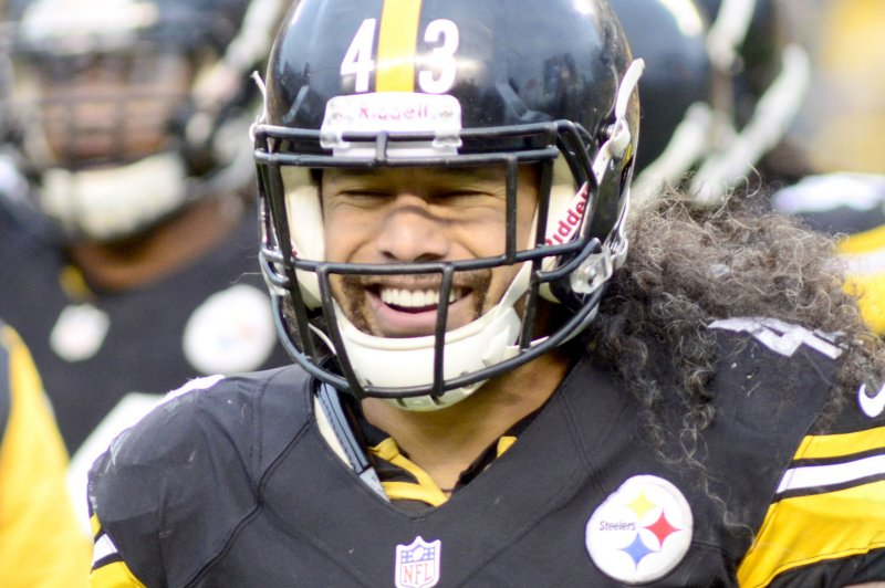 steelers polamalu to cut famous hair for veterans