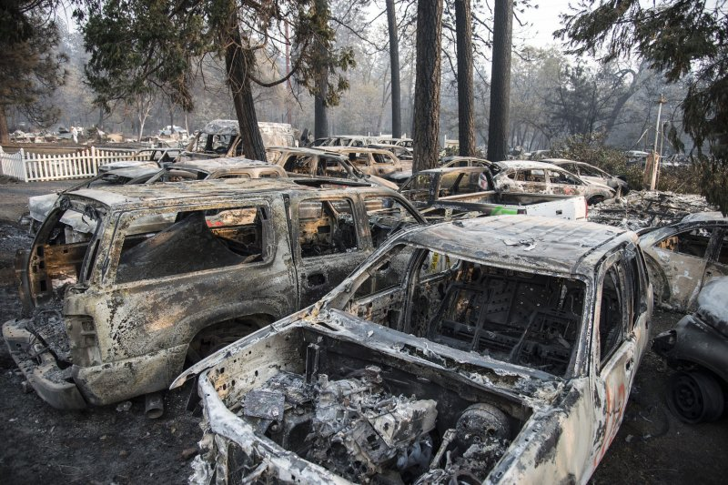 Donald Trump visits site of Camp Fire as death toll rises ...