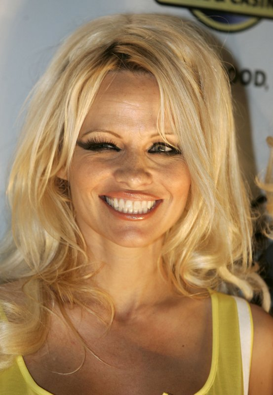 Pamela Anderson Photos with her new PETA stamp at the