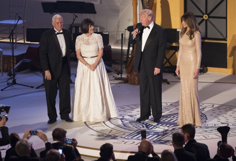 Look: Melania Trump wears gold Reem Acra gown at pre-inauguration ...