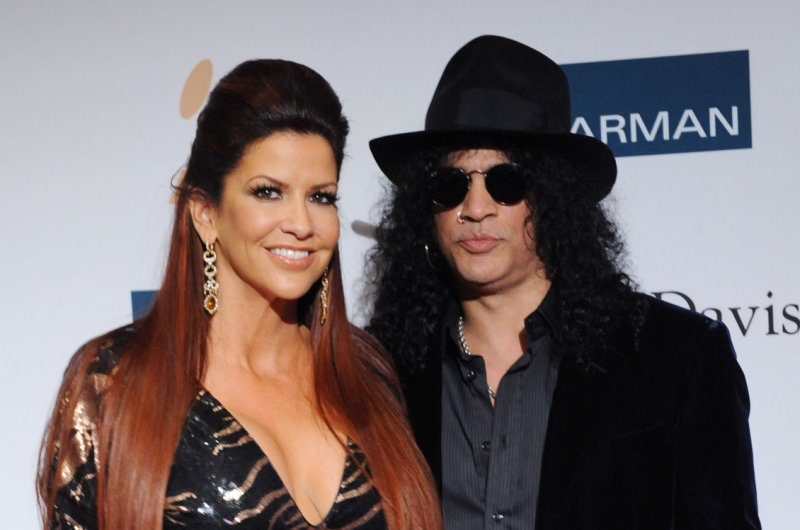 Slash files for divorce from wife Perla Ferrar - UPI.com