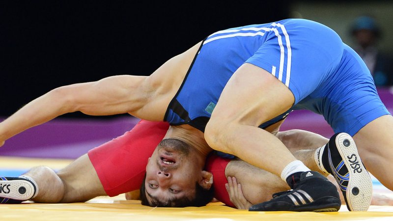 Save Olympic Wrestling Cover Photo Wrestling reins...