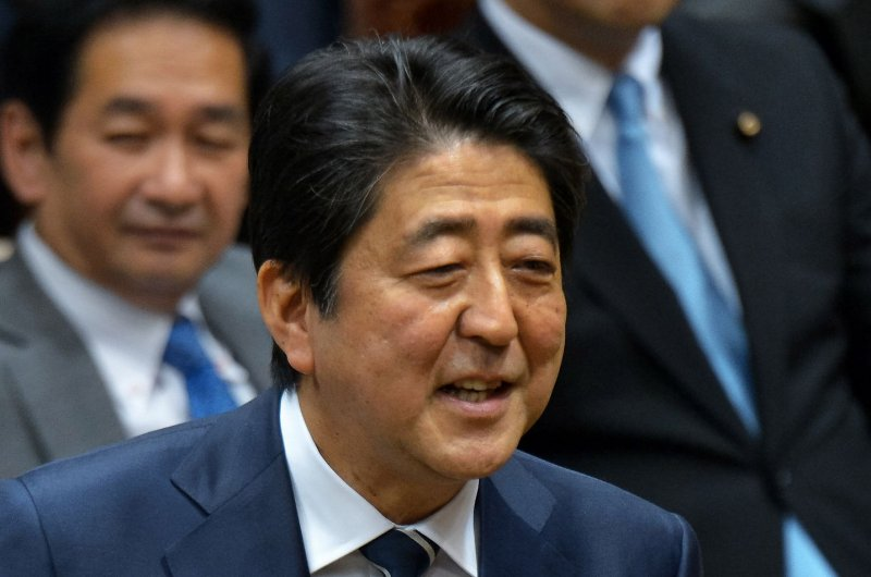 Japan's Shinzo Abe criticized for 'golf summit' with Donald Trump
