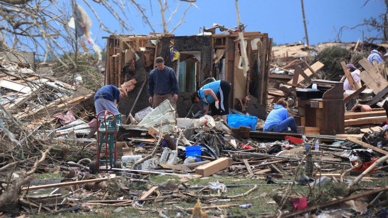 Tornado death toll lowered after victims double counted ...