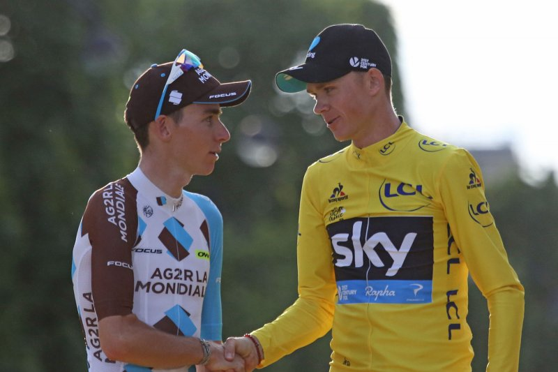 Defending champion Chris Froome escaped an action-packed ninth stage of the  Tour de France as two of his main rivals crashed out of the race on Sunday. 9741230f6