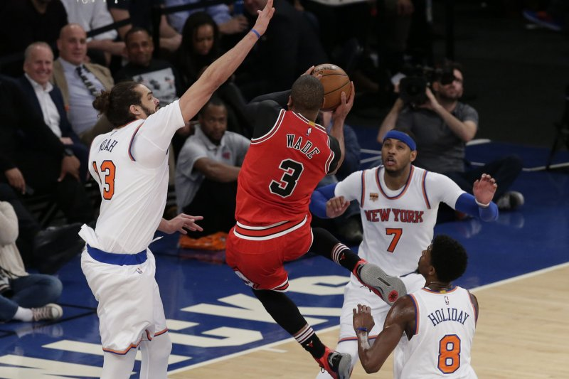 Cleveland cavaliers appear to be frontrunner to land dwyane wade new york knicks joakim noah and carmelo anthony watch and chicago bulls dwyane wade drive to the basket in the second half at madison square garden in new voltagebd Images
