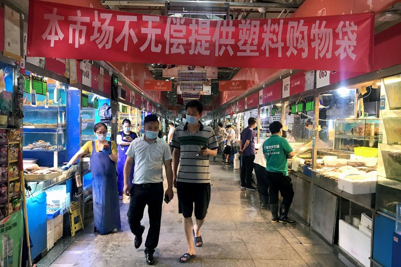 China says virus tests negative on seafood in...