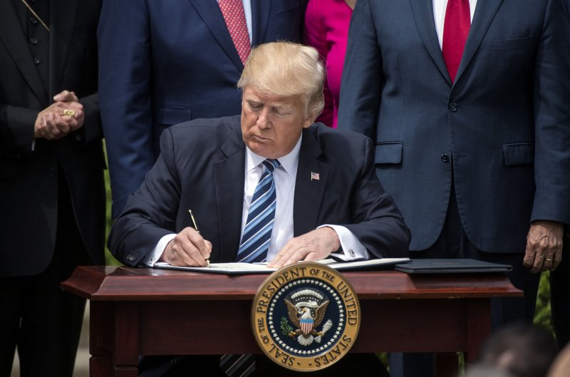 Donald Trump signs order relaxing rules on political ...