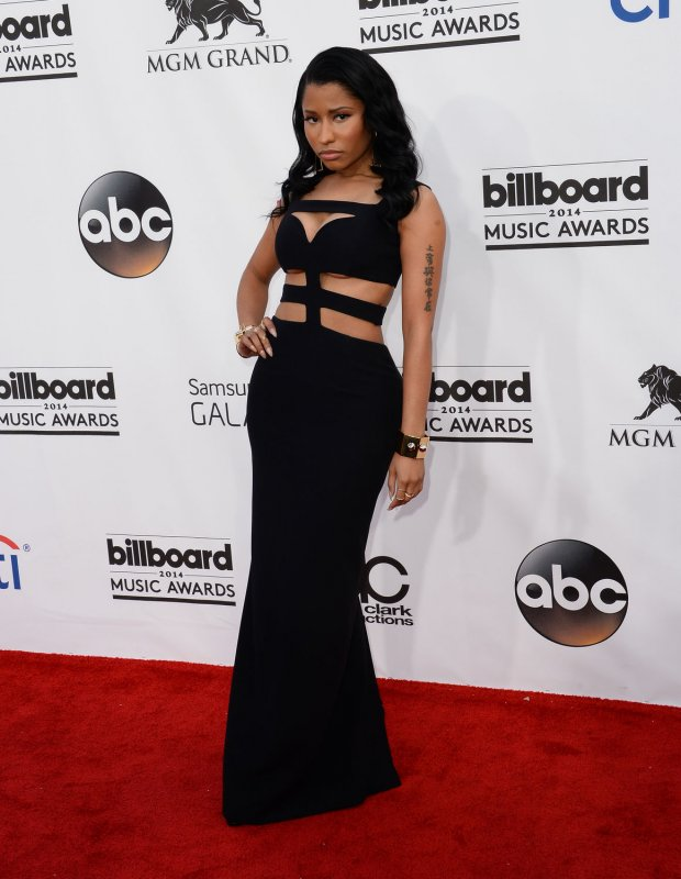 Nicki Minaj steps out in risque cut-out dress at 2014