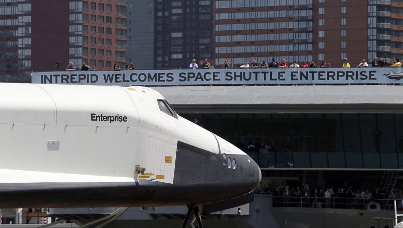 Space Shuttle Enterprise lands at Intrepid Museum in New ...