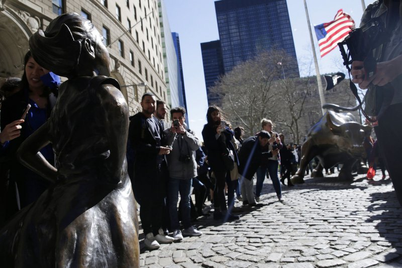 4eb76afdec4c1e March 27 (UPI) -- The statue of a young girl standing firmly with her hands  on her hips -- in the path of Wall Street's famous