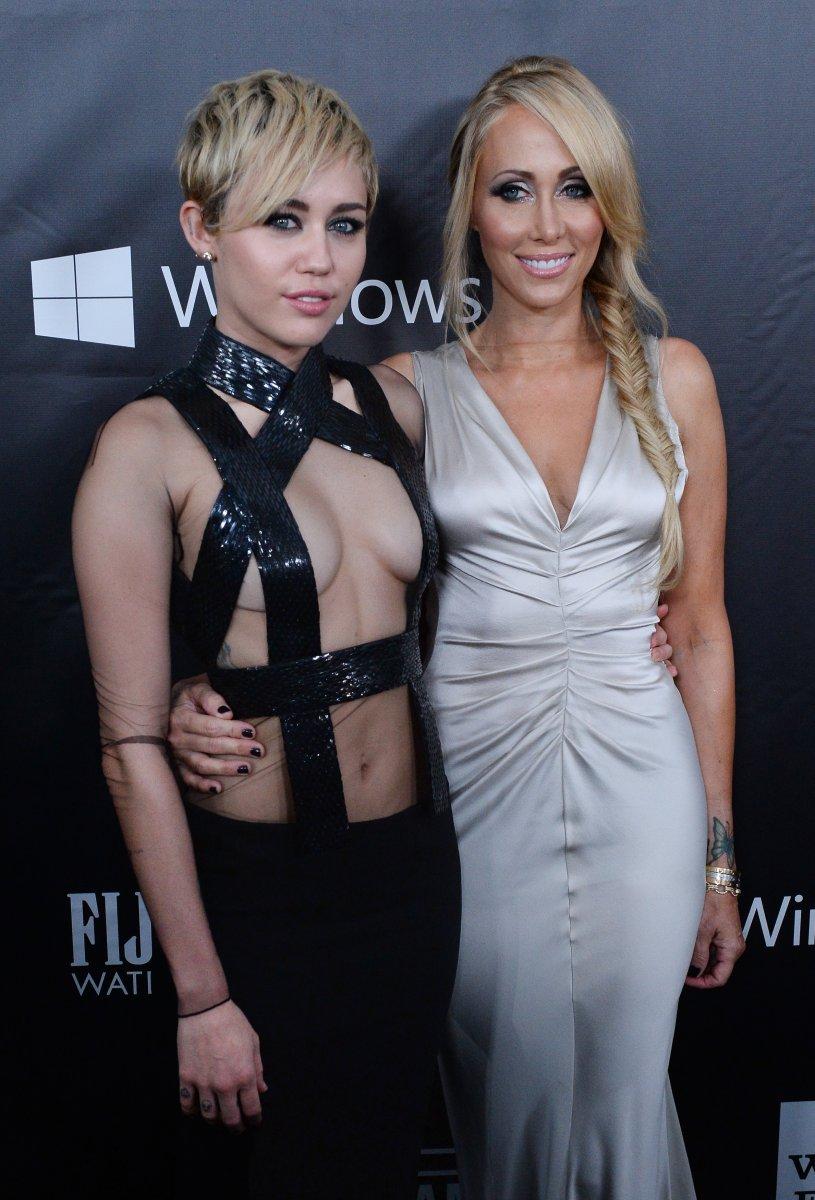 Ford Racing Parts >> Miley Cyrus dons revealing bondage dress at amfAR Gala ...