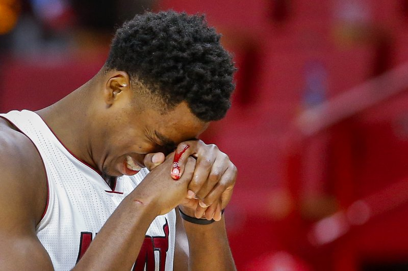 Miami Heat coach Erik Spoelstra paid center Hassan Whiteside a left-handed  compliment. There was no disrespect involved in the remark.