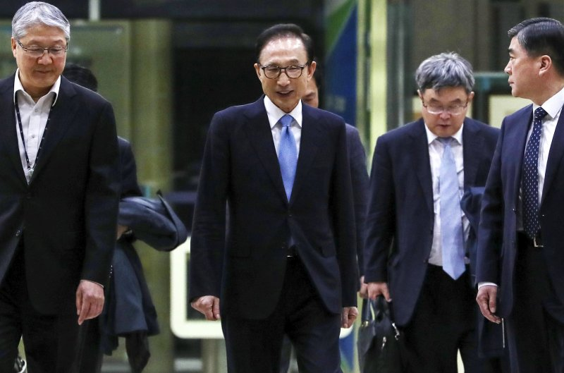 a4f9f190ed South-Koreas-former-President -Lee-Myung-bak-to-stand-trial-on-corruption-charges.jpg
