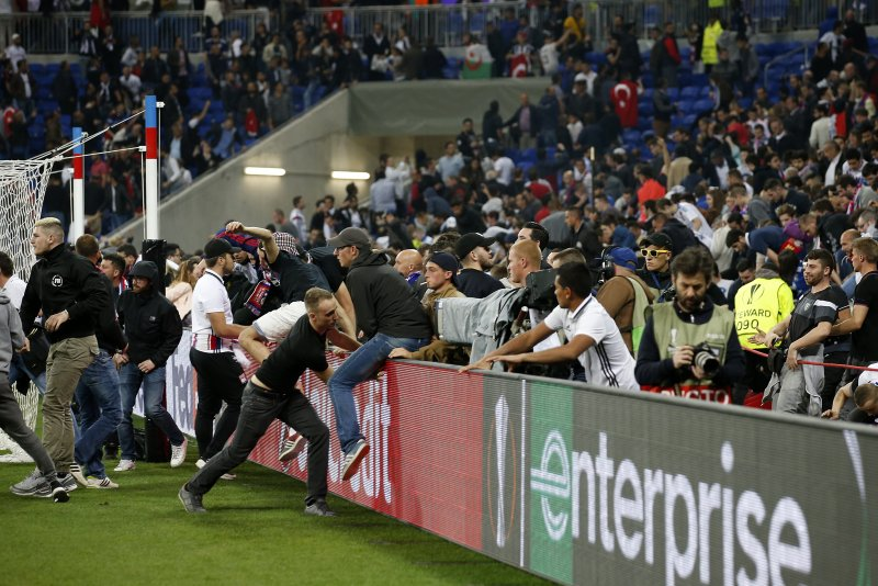 watch  french fans mob soccer team on the field