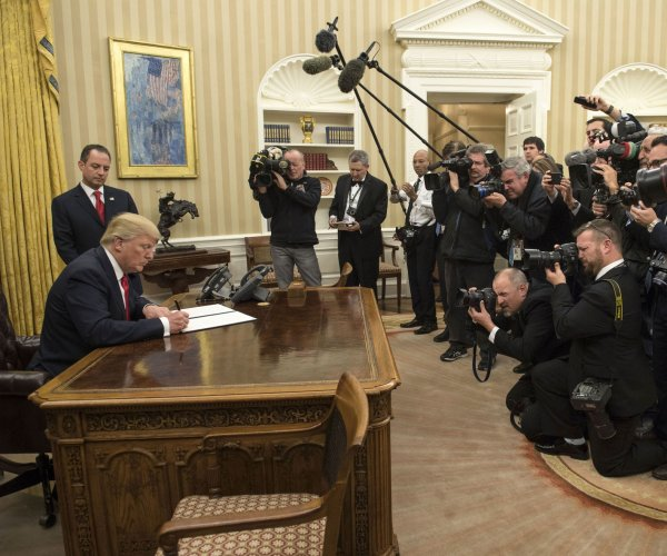 Trump issues executive order to ease 'economic burden' of ACA