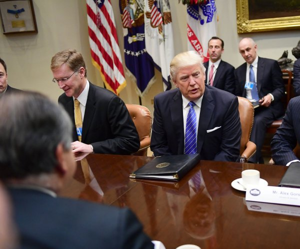 Trump to CEOs: Expect regulation rollback, tax on goods made outside U.S.