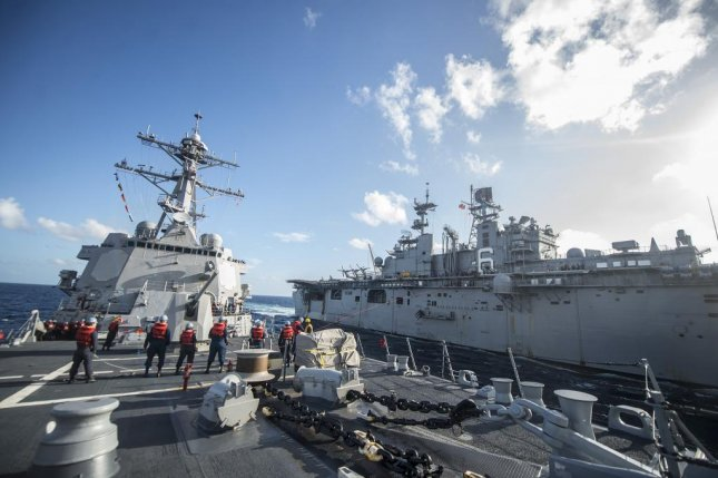Sailors on the guided-missile destroyer USS Preble maintain phone and distance lines as the ship conducts a replenishment-at-sea with the amphibious assault ship Bonhomme Richard. The commander of U.S. Naval Forces Korea said he plans to strengthen cooperation between the Navy's Seventh Fleet and the South Korea Navy. Photo courtesy of U.S. Navy