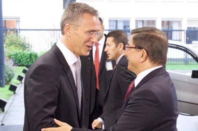 A meeting of NATO Secretary-General Jens Stoltenberg, left, and Turkish Prime Minister Ahmet Davutoglu on Monday suggested complicity between NATO and Turkey in the downing of a Russian fighter plane, a Russian legislator said. Photo courtesy of NATO