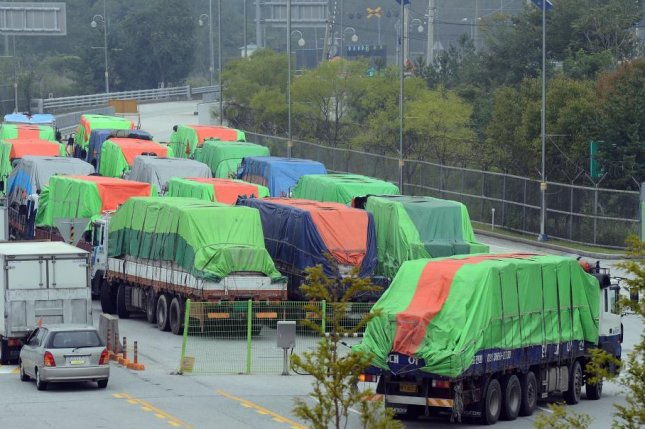 South Korean trucks carrying 500 tons of flour for North Korean flood victims, pass the transit office near the demilitarized zone (DMZ) in Paju, Gyeonggi Province, South Korea, on Sept. 21, 2012. Photo by Bae Woo-han/EPA
