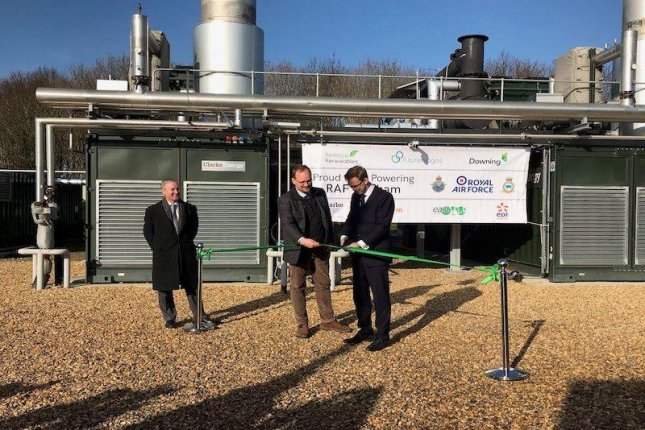 British Defense Minister Tobias Ellwood, R, ceremonially opened a biogas plant on Thursday in Swaffham, England, which will provide the nearby RAF Marham air base with 95 percent of its electricity needs. Photo courtesy of U.K. Ministry of Defense/Twitter