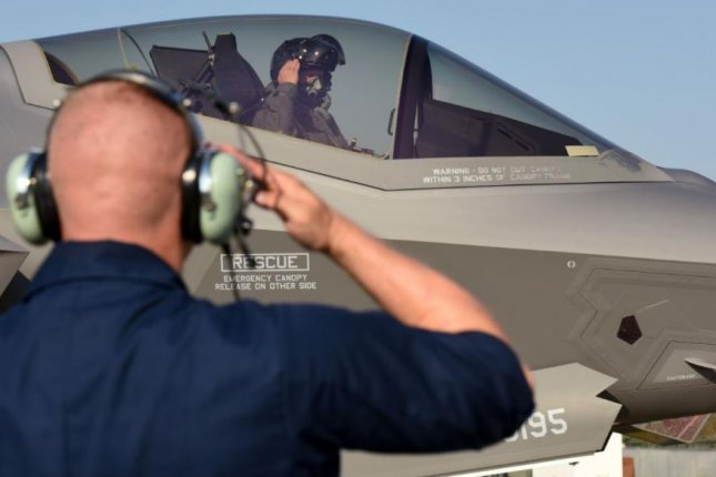 Senior Airman Christopher Kuhn, 421st Aircraft Maintenance Unit crew chief, salutes Lt. Col. Max Cover, 421st Fighter Squadron F-35A Lightning II fighter pilot, during Astral Knight 2019 multinational exercises at Aviano Air Base, Italy, on June 3, 2019. Photo by Tech. Sgt. Jim Araos/U.S. Air Force/UPI