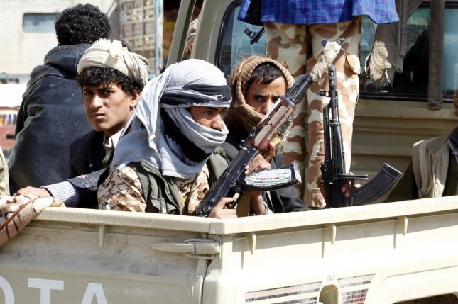 Armed Houthi fighters engage in clashes with forces loyal to former Yemeni leader Ali Abdullah Saleh. File Photo by Yahya Arhab/EPA