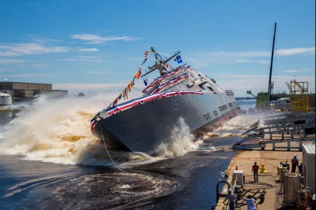 The U.S. Navy's future USS Billings launches sideways into the Menominee River in Marinette, Wis., after its christening on July 1, 2017. The Navy took delivery of the ship Friday during a ceremony. Photo courtesy Lockheed Martin/U.S. Navy