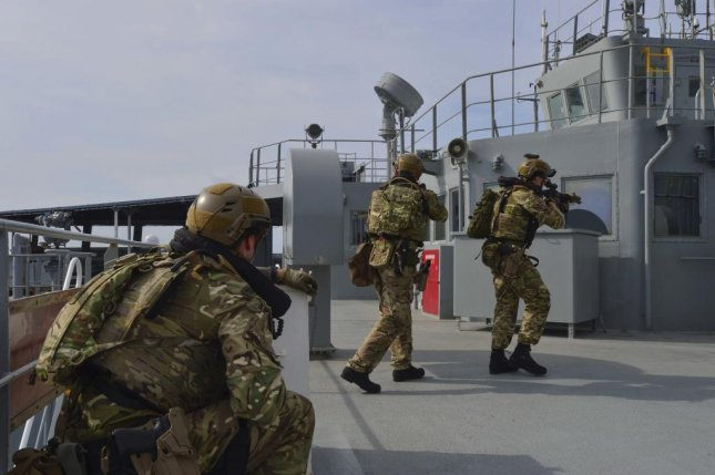 Royal Marine commandos and Royal Navy sailors attached to the frigate HMS Montrose boarded, searched and seized the replenishment oiler USNS Guadalupe during drills Monday in the South China Sea. Photo by Mass Communication Specialist 2nd Class Tristin Barth/U.S. Navy