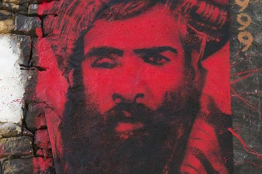 A painted portrait of Mullah Mohammed Omar, leader of the Taliban in Afghanistan, who recently indirectly supported peaceful negotiations to end the country's 14-year war. File Photo by thierry ehrmann/Flickr
